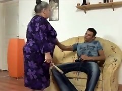 big beautiful woman grandmother takes youthful strap dildo