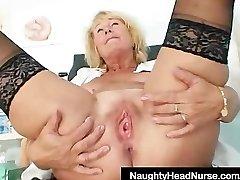 Platinum-blonde milf Greta big congenital boobs and uniform