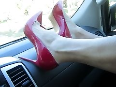 modeling and putting on my Stuart Weitzman crimson pumps
