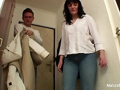 Busty black-haired granny fucks on the floor