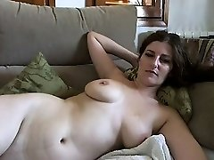 Huge-titted mature black-haired with huge boobs and hairy pussy strips