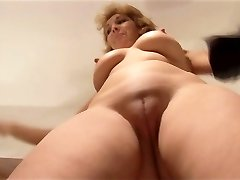 Attractive Mature female stripping and demonstrating off nice pussy