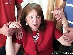 Tearing Up big-boobed granma in stockings from both sides