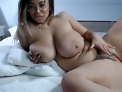 Romanian chubby mature toying her tattoo pussy on bed