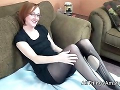 Mature glasses wearing redhead in tights
