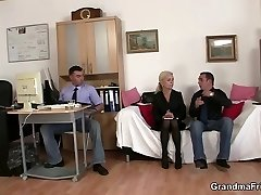 Two guys share old blond in the office