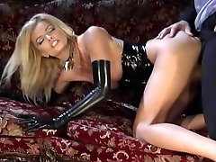 Cool platinum-blonde in black latex gets deep drilling on a couch