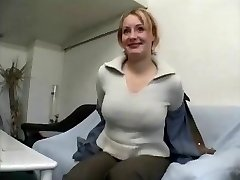 Plump mature ash-blonde female gives interview and undresses
