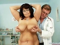 Huge-titted mature woman Daniela tits and mature pussy gyno exam