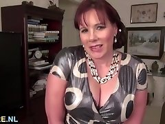Large titted mature brunette using a massive dildo