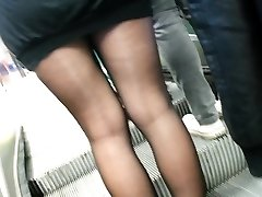 Sheer black tights and short skirt.