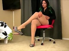 Latina In Short Black Skirt And White Tights