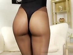 Doll in sheer black pantyhose at home