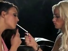 Smoking lesbians kissing on dark-hued sofa + 120's