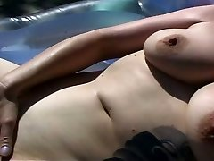 Horny MILF squirting by the pool