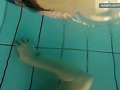 Loris blackhaired teen swirling in the pool