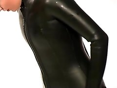 Dressing in beavertail wetsuit & knee boots, wearing black spandex catsuit