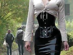 Lady dark-hued latex skirt outdoor