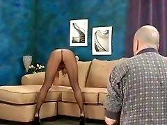 Brunette wears dark-hued pantyhose full of semen