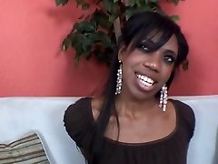 Hot ebony girl fellates penis on the couch and gets her mouth cum jizzed
