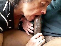 Hungry granny eating a big black weenie