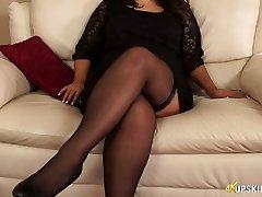 Incredible voluptuous brunette Milf in nylon black stuff exposes her cunt
