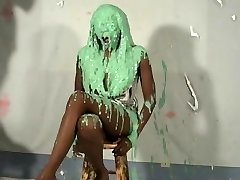 cute dark-hued girl pied and slimed