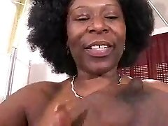 Busty African Mature Has Thick Hooters!!
