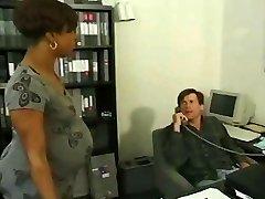 Pregnant ebony takes milky cock in the office