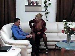 Ebony superslut in black fishnet stockings sucks cock