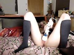 Lusty ash-blonde teacher toys her muff in black stockings