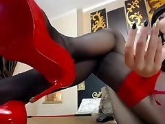 Damsel in ebony pantyhose tease her red high heels