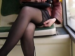 Girl showing ebony stockings in a bus