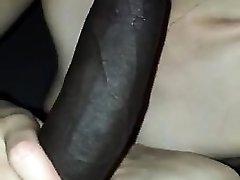 Bi-racial busty slut sucks humungous black cock at gloryhole