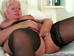 Chubby grandma with big globes wears black stockings and masturbates