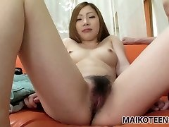 Pale skin brownhead Yuna Uchiyama gets her small milk cans squeezed and her rosy pussy finger-tickled in closeup flick.