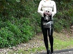 Lady black latex miniskirt outdoor