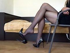 Dangling my ebony stiletto high heels wearing black stocking