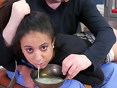 Hot dark-hued submissive woman punished with a bowl of cum