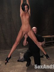 India Summer is one hot and horny MILF who gets dominated and fucked hard by Mark Davis.  Her incredibly fit body is stretched out in a wrist suspension and she is fingered and flogged.  Then with blindfold she endures clamps on sensitive areas of her body and is orders to crawl and suck cock which she says is her specialty.  Next India's head is locked in a steel hole in the ground leaving her perfect ass exposed for punishment and fucking.  An infrared camera captures her facial expressions and displayed on a wall monitor.  Lastly, she is bound with legs spread wide and takes bastinado, hot wax, more pounding and a giant load on her pretty face.