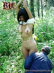 Cute student damsel gets tied up in a woods
