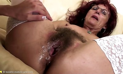Deep fisting for stellar mature mummy's hairy pussy