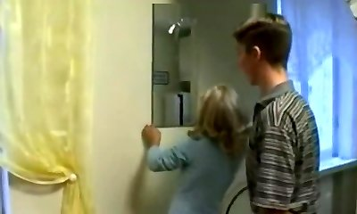 Son Helps Not His Mom Hang Curtains