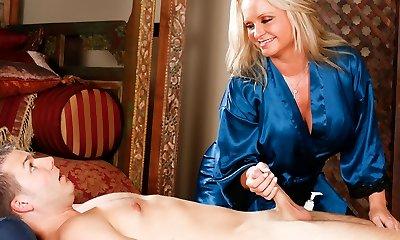 Maya Devine massaging a much younger guy