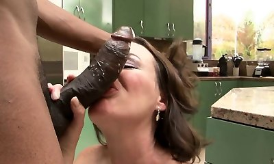 Black dick drills a fur covered pussy