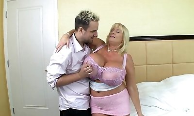 Blonde mature with huge silecone bosoms