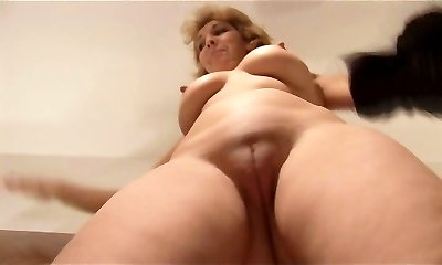 Attractive Mature lady stripping and showcasing off lovely pussy