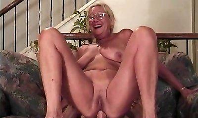 Mature blonde with glasses sucks a pecker