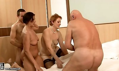 Two hefty moms make out with their paramours in group sex orgy