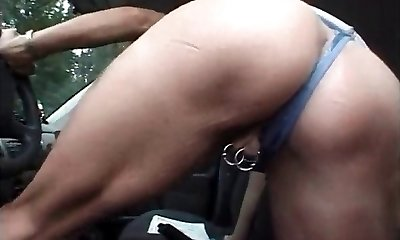 MILF with pierced pussy and nipples tugging in the van